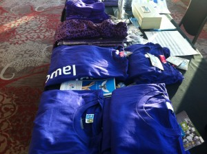 Purple clothing displayed on a table at the International Women's Day Breakfast