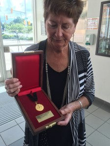 Deanne Hart reveals the Pierce Medal, presented the families of firefighters who have lost their lives in the line-of-duty