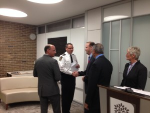 Mayor Matt Brown and Councillor Stephen Turner shake hands with Chief of Police John Pare.