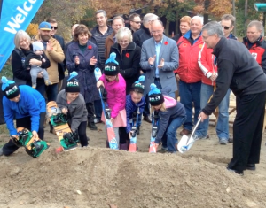 Using snowboards and skis, children broke ground on the project.